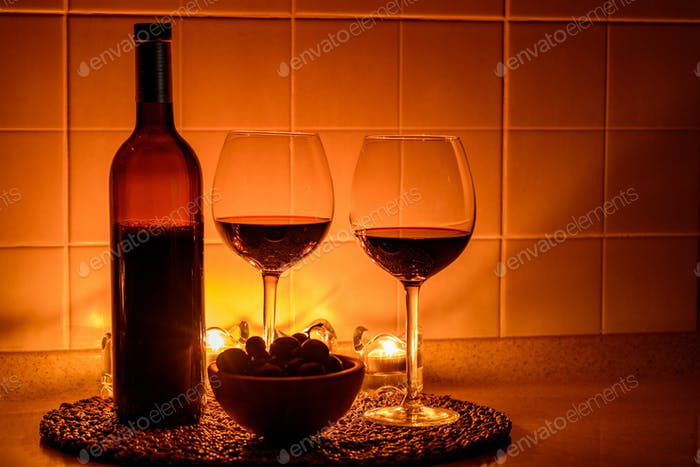 Romantic background with glasses of wine