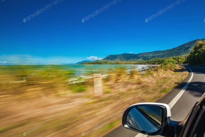 Road trip with motion blur along Ellis Beach near Palm Cove and