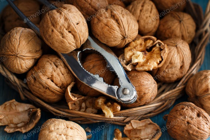 Fresh walnuts on a blue wooden table