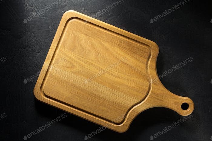 cutting board at black table