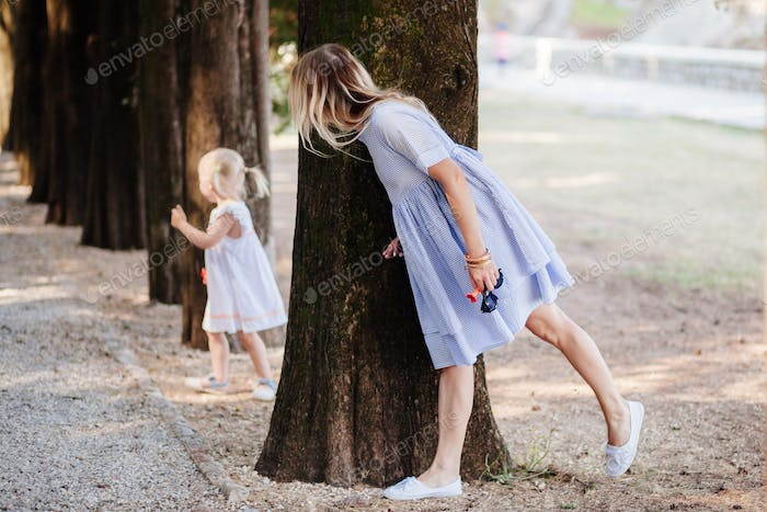 mother playing hide with daughter