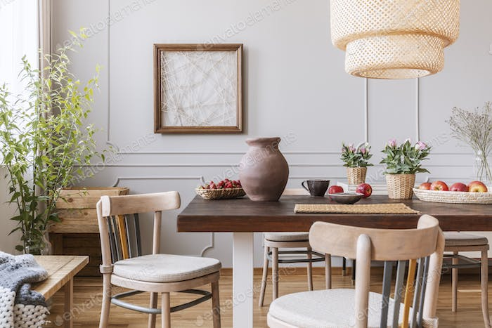 Vintage wooden chairs in living room with long table with strawb