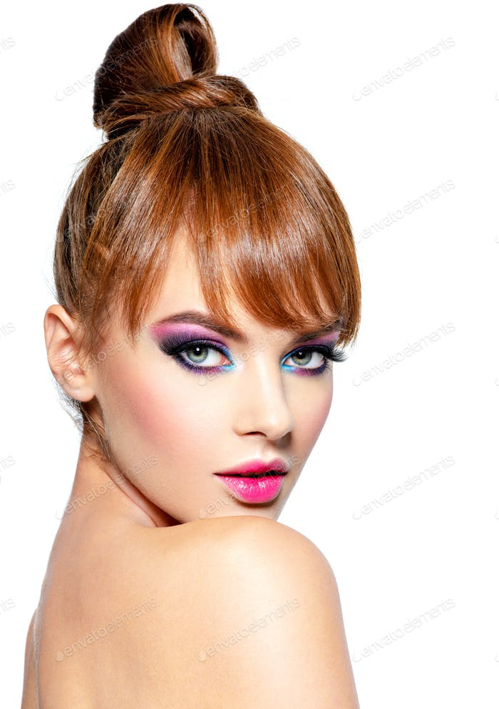 Beautiful woman with creative hairstyle and vivid make-up.