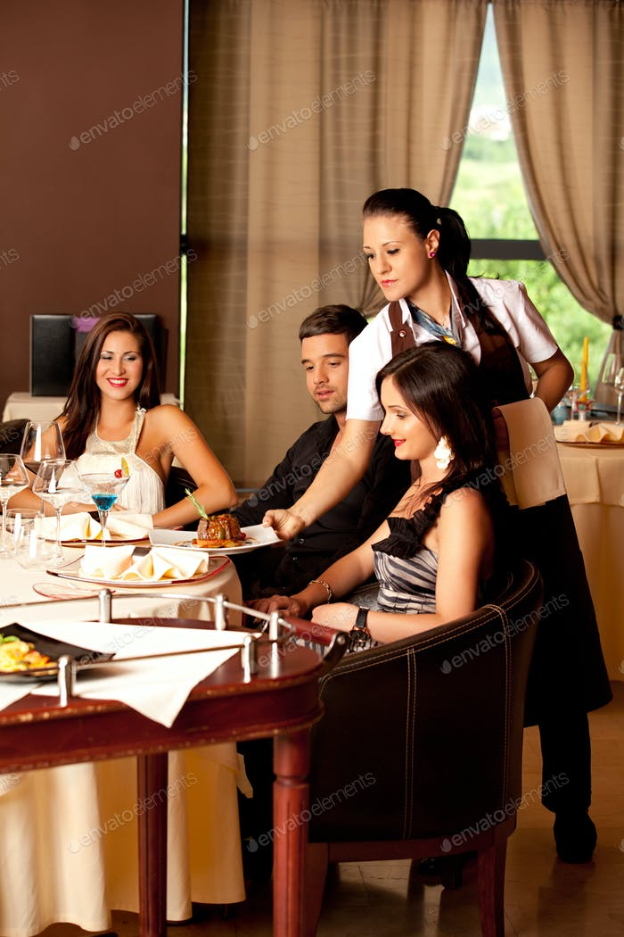 woman serving food restaurant table