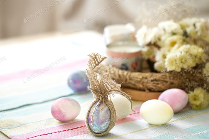 Easter composition with festive eggs on blurred background.