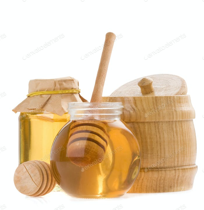 glass pot of honey and stick