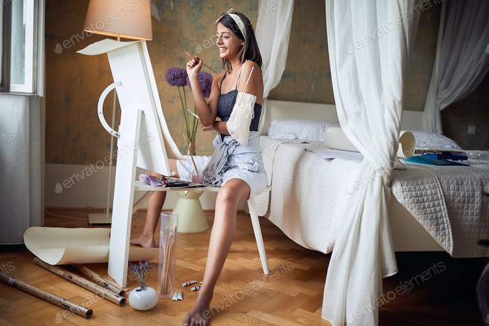 Woman working creating arting process.Beautiful  girl painting.