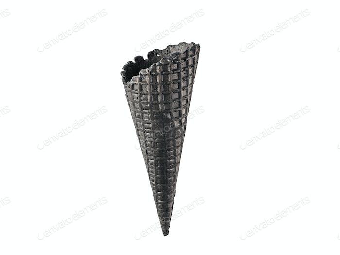 Black waffle sugar cone isolated on white