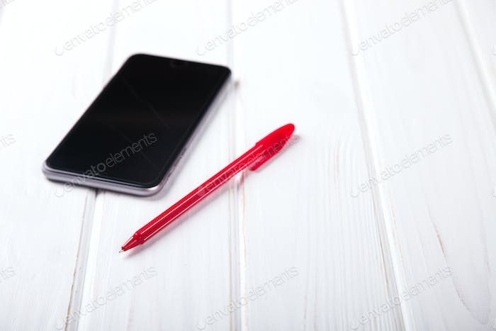 Smartphone and Pen Business concept.