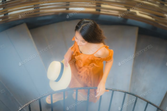 Portrait beautiful young asian woman walk on circle stair