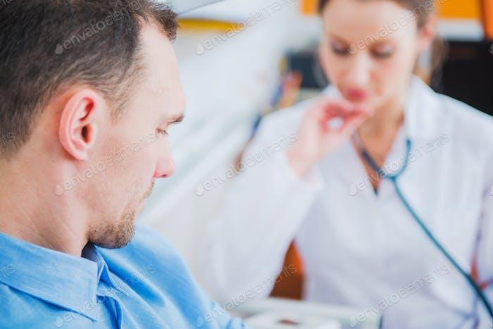 Men Visiting Doctor Office