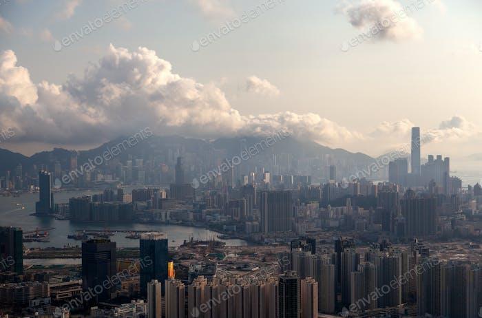 Cityscape modern Hong Kong buildings surround calm sea bay