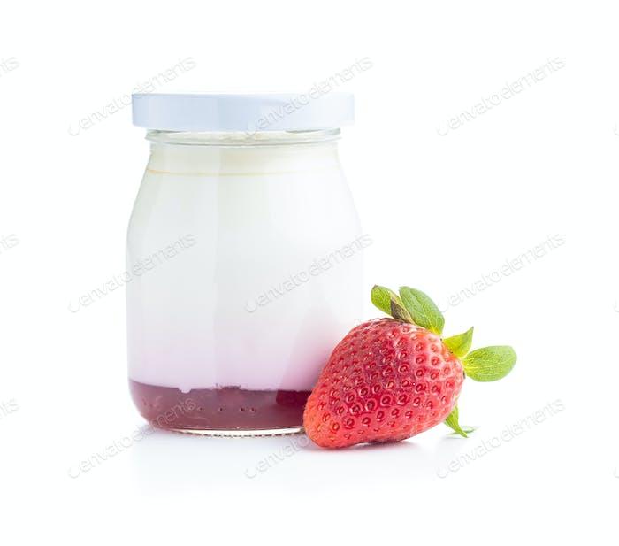 White fruity yogurt in jar and strawberries