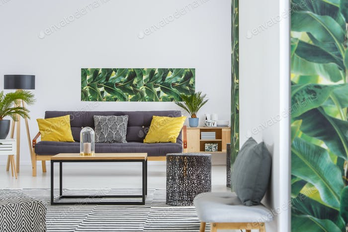 Spacious living room with poster