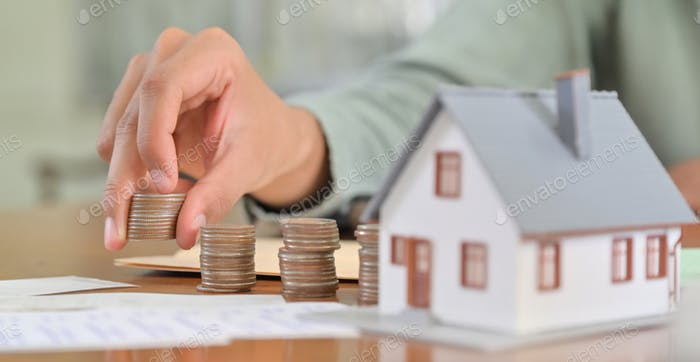 Concept of saving money to buy a house.
