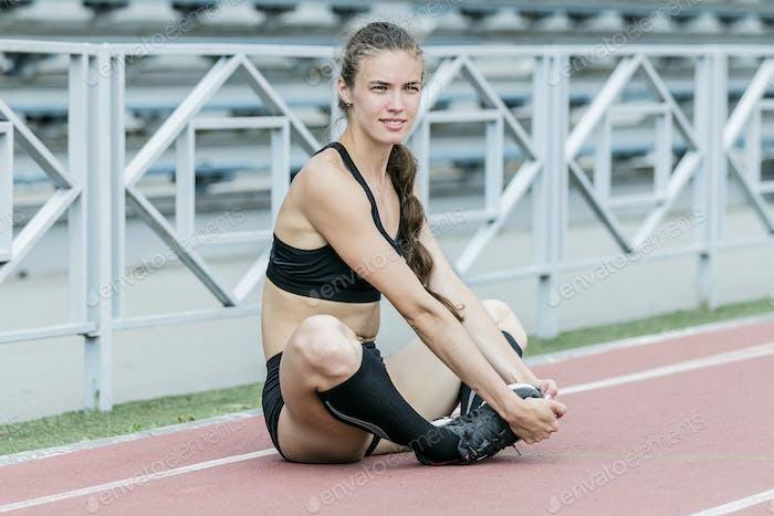 Girl athlete doing stretching exercises