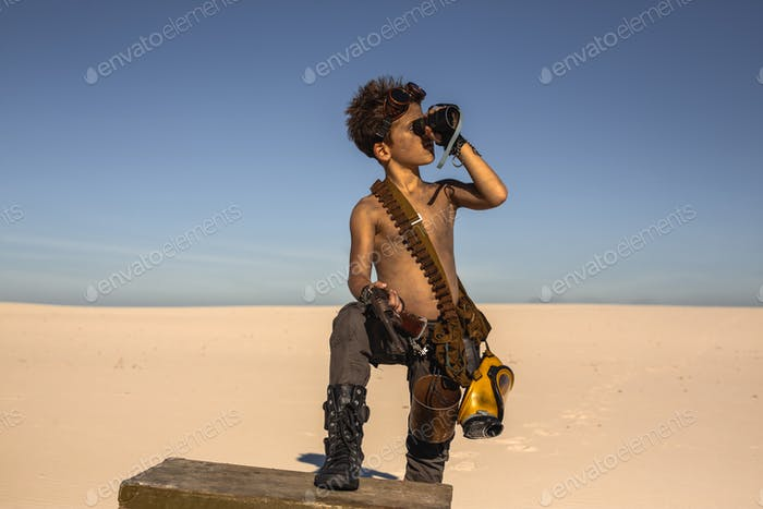 Post-apocalyptic boy outdoors in desert