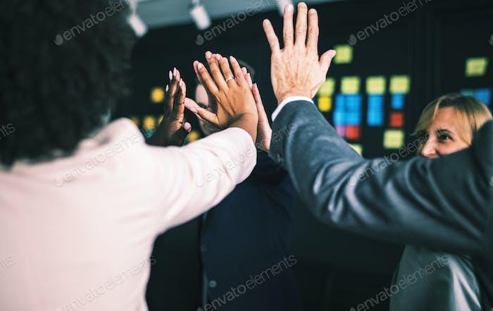 Business team giving a high five