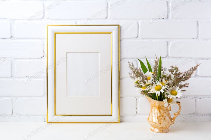 Gold decorated frame mockup with chamomile and grass in golden v