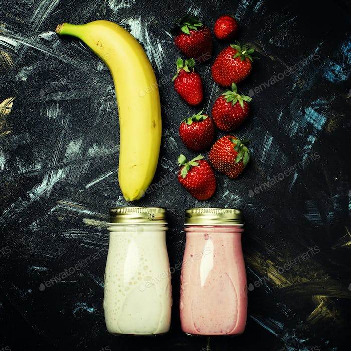 Fruit smoothies or milkshakes with strawberries and banana