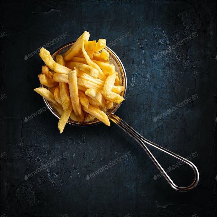 French fries in fancy metal basket