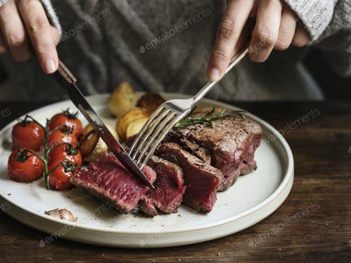 Close up of a cutting a fillet steak food photography recipe idea