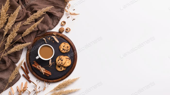 composition of coffee, biscuits and spicas on white