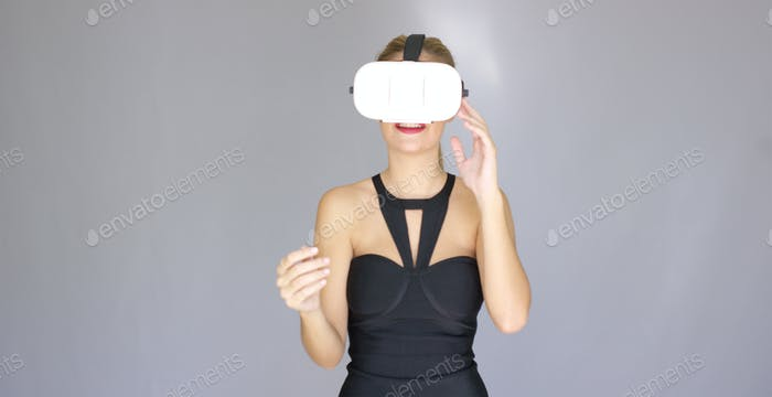 Beautiful sexy blond girl enjoys virtual reality glasses
