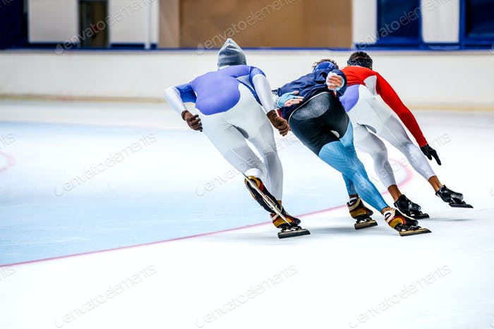 Three Athletes Speed Skating