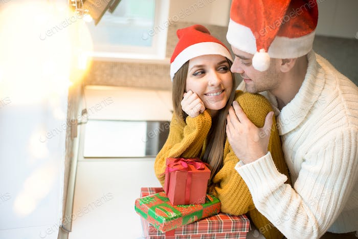 Loving couple with presents for Christmas