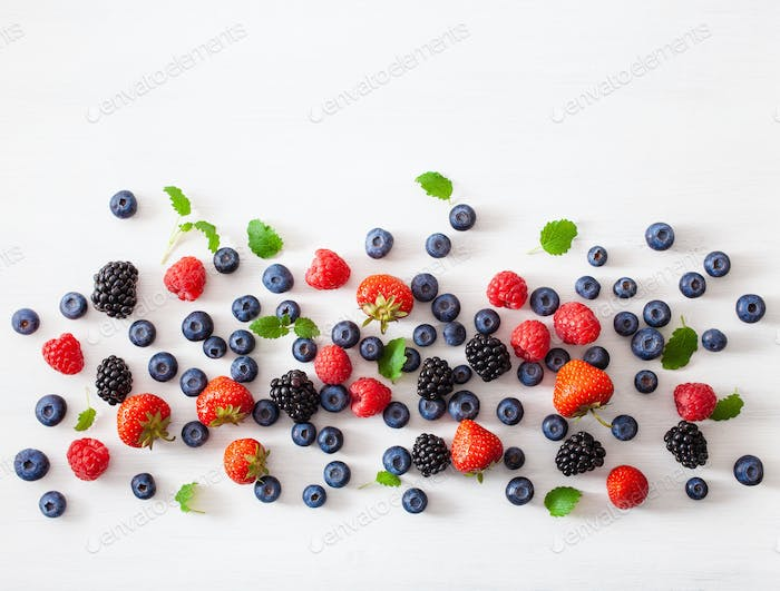 assorted berries over white background. blueberry, strawberry, r