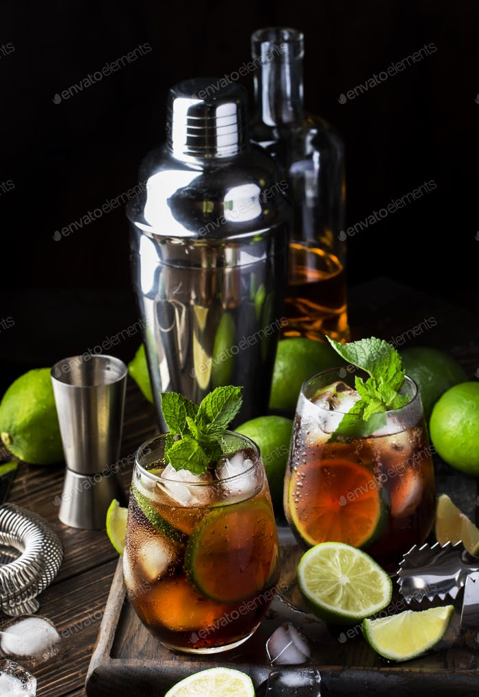 Cuba libre or rum cola cocktail with strong alcohol, lemon juice, lime and ice