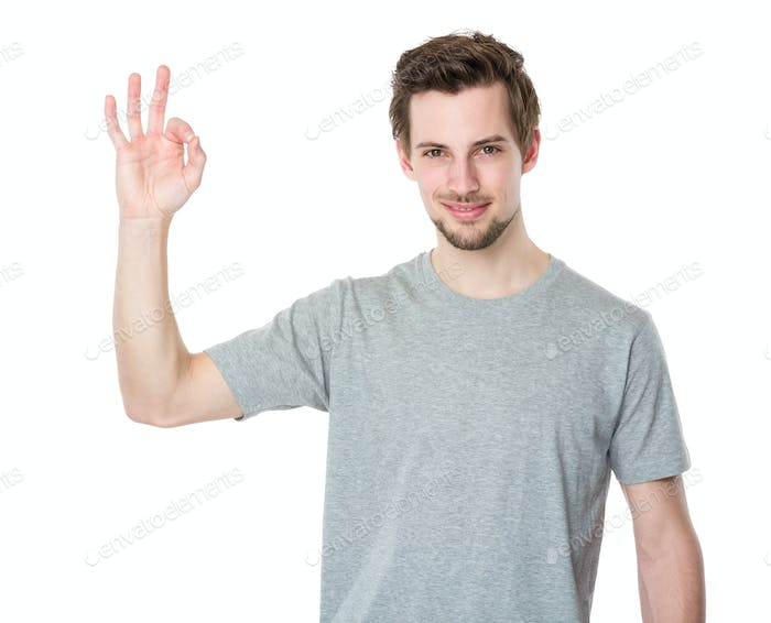 Young man gesturing okay sign
