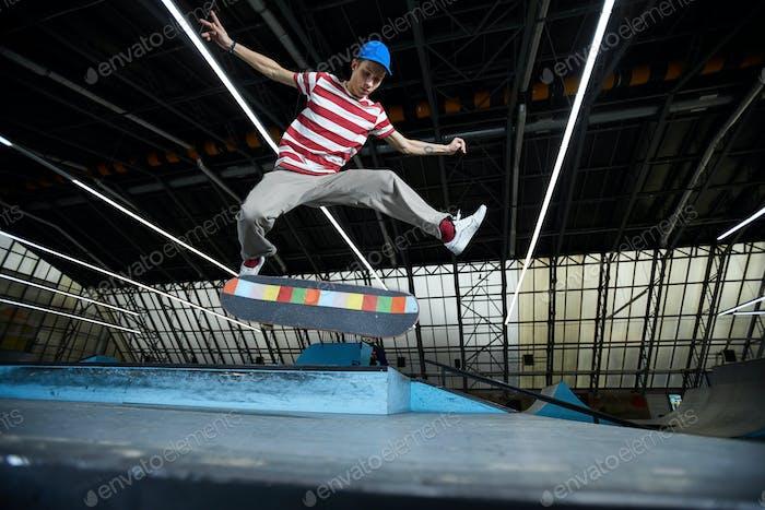 Jumping over skateboard