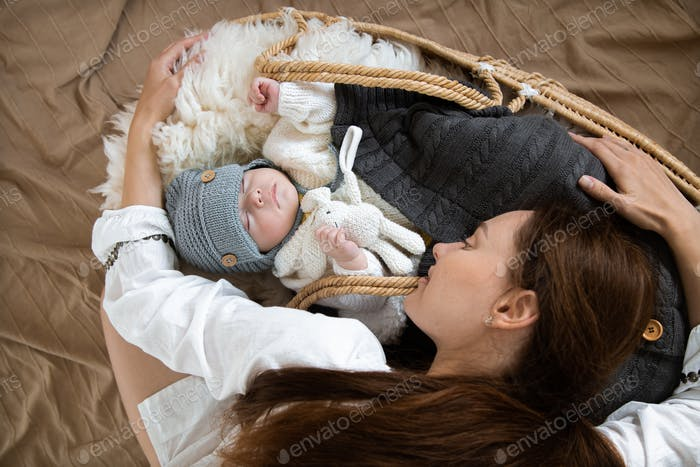Young mother and a sleeping baby.