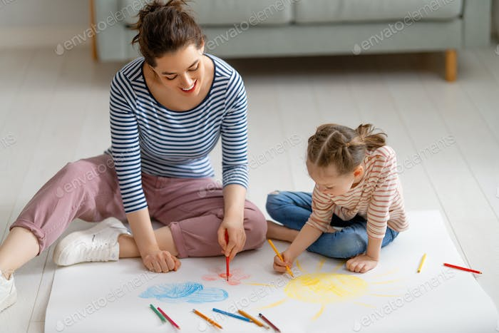 Mother and daughter are drawing