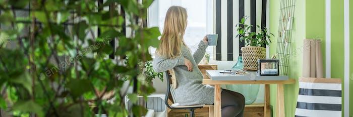 Drinking coffee in office