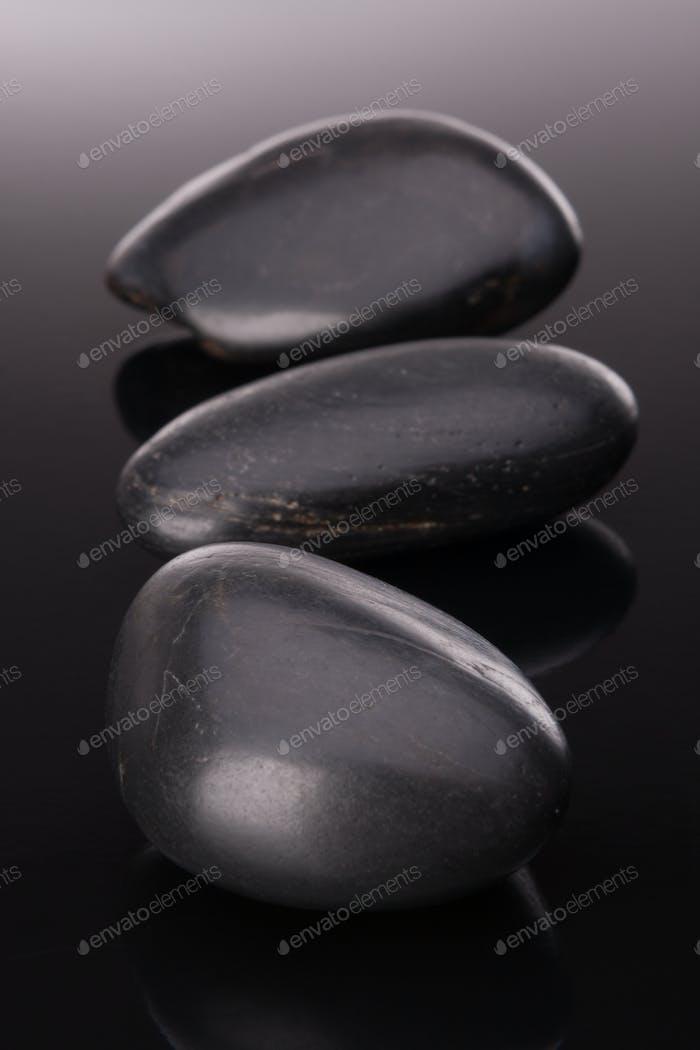 Spa stone arrangement on black surface