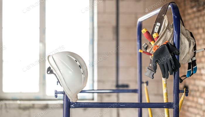 Working construction tool. Builder's accessories. House and house renovation concept.