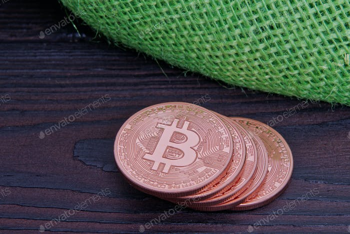 Bronze Bitcoins on a table