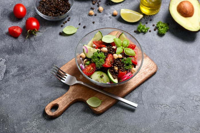 Healthy Chickpea and Lentil Salad with Vegetables and Avocado, Vegan Lunch Bowl, Dieting Concept