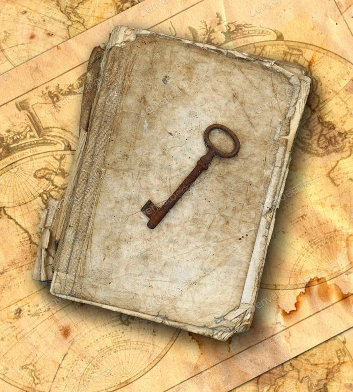 Tattered book and old rusty key on the old maps
