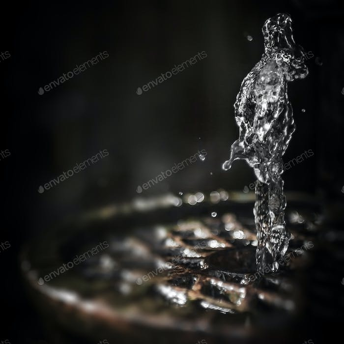Water splash freeze motion as human figure