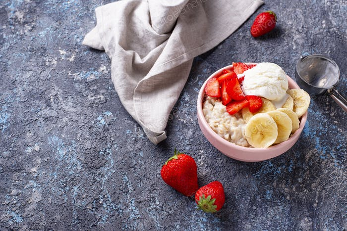 Oatmeal with strawberry, banana and ice cream