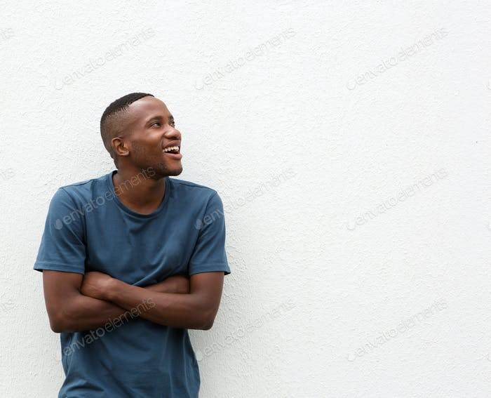 Happy african american guy looking at copy space