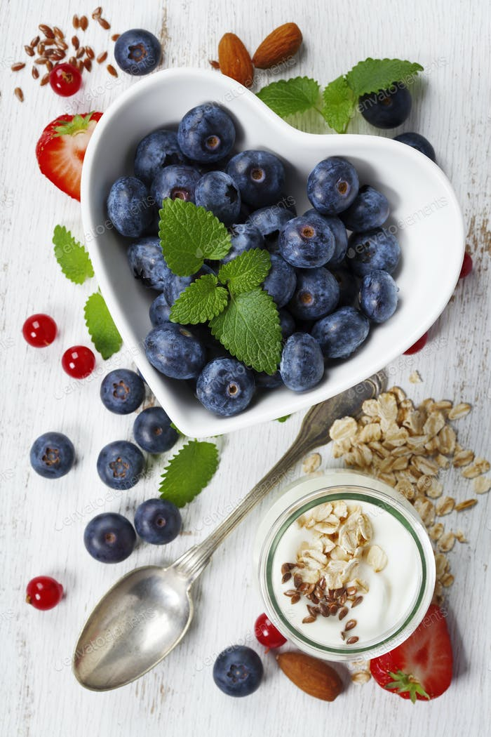 Healthy breakfast of muesli, berries with yogurt and seeds