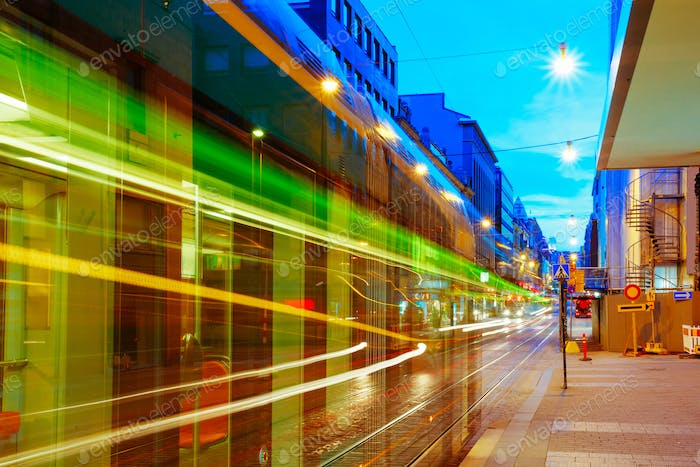 Helsinki, Finland. Tram Departs From A Stop On Street Aleksanter