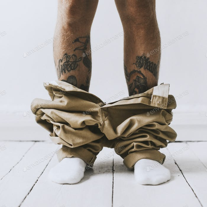 Tattooed man caught with pants down