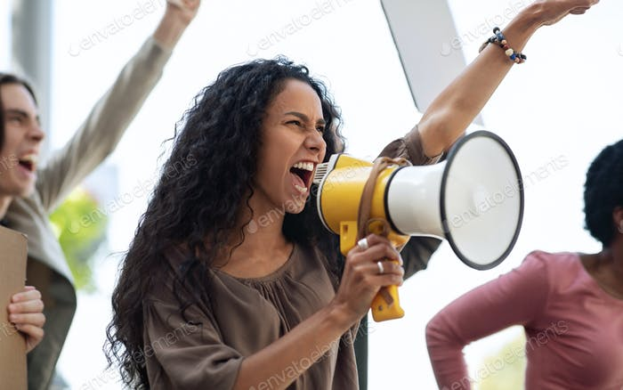 Closeup of motivated woman leading group of strikers