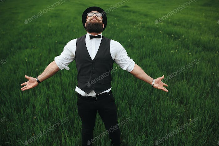 man with a beard walking on the field